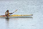 An older man enjoying kayaking the Milwaukee Harbor, Wisconsin in late Summer