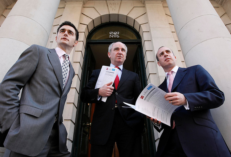 "Rossa White, Chief Economist, Davy (left) with Bernard McAlinden, Head of Research and Stratagey, NCB and Eamon Hughes, Head of Research, Goodbody Stockbrokers (right), pictured here at the announcement of the joint Davy/Goodbody/NCB report ""Charting the Course to Irish Economic & Financial Stability"", held in the Royal College of Physicians, Dublin. Pic. Robbie Reynolds."