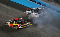 Apr 20, 2007; Avondale, AZ, USA; Nascar Busch Series driver Juan Pablo Montoya (42) goes low to avoid a spinning Steve Wallace (66) during the Bashas Supermarkets 200 at Phoenix International Raceway. Mandatory Credit: Mark J. Rebilas