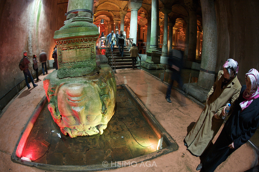 Istanbul. Yerebatan Cistern. Girls with headscarfs visiting the Medusa.