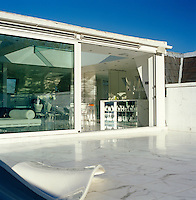 The roof terrace is laid with Carrara marble which has also been used for the flooring inside the penthouse