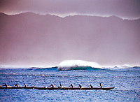 A canoe clug paddles into the shore at Haleiwa on the north shore of Oahu