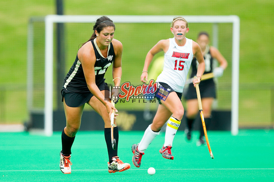 Anna Kozniuk (22) of the Wake Forest Demon Deacons brings the ball up the field against the Louisville Cardinals at Kentner Stadium on October 14, 2012 in Winston-Salem, North Carolina.  The Cardinals defeated the Demon Deacons 2-1.  (Brian Westerholt/Sports On Film)
