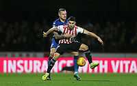 Brentford's Neal Maupay and Bolton Wanderers' David Wheater<br /> <br /> Photographer Rob Newell/CameraSport<br /> <br /> The EFL Sky Bet Championship - Brentford v Bolton Wanderers - Saturday 22nd December 2018 - Griffin Park - Brentford<br /> <br /> World Copyright © 2018 CameraSport. All rights reserved. 43 Linden Ave. Countesthorpe. Leicester. England. LE8 5PG - Tel: +44 (0) 116 277 4147 - admin@camerasport.com - www.camerasport.com