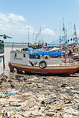 "Belem, Para State, Brazil. Ver-o-Peso fish market harbour, with rubbish and vultures. ""Daughter of God"" (Filha de Deus) river boat."