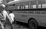 In Philadelphia, Ms, State Trooper and teen pass Segregated School bus long route of 2nd Meredith March Against Fear through Mississippi photographed by Jim Peppler for essay published in The Southern Courier on June 25, 1966. Copyright Jim Peppler/1966. This and over 10,000 other images are part of the Jim Peppler Collection at The Alabama Department of Archives and History:  http://digital.archives.alabama.gov/cdm4/peppler.php