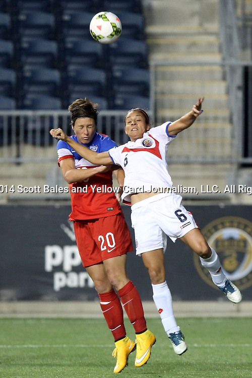 26 October 2014: Abby Wambach (USA) (20) and Carol Sanchez (CRC) (6). The United States Women's National Team played the Costa Rica Women's National Team at PPL Park in Chester, Pennsylvania in the 2014 CONCACAF Women's Championship championship game. By advancing to the final, both teams have qualified for next year's Women's World Cup in Canada. The United States won the game 6-0.