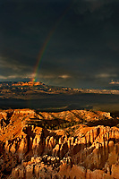 730750188v a rainbow forms over bryce point and the paunsaugunt plateau  during a monsoon summer thunderstorm utah united states