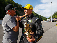 Jun 18, 2017; Bristol, TN, USA; NHRA pro stock driver Alex Laughlin celebrates with crew after winning the Thunder Valley Nationals at Bristol Dragway. Mandatory Credit: Mark J. Rebilas-USA TODAY Sports