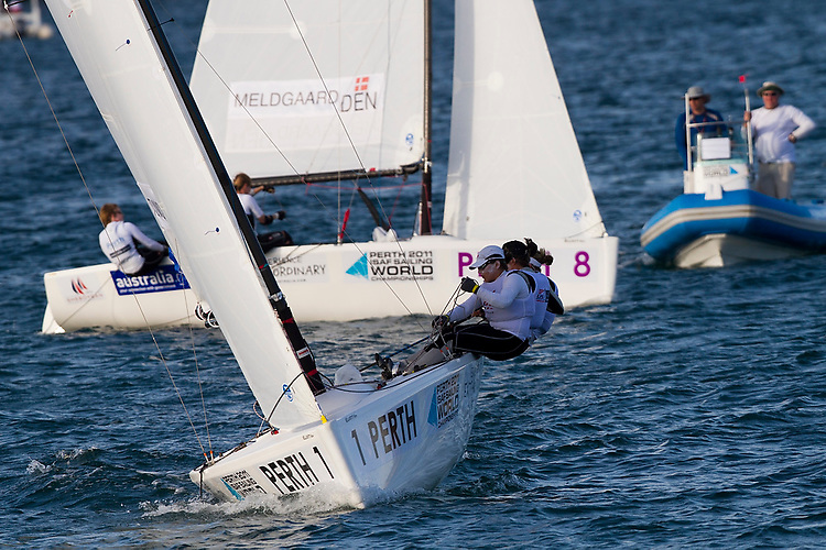 20111203, PERTH, AUSTRALIA: PERTH 2011 ISAF SAILING WORLD CHAMPIONSHIPS - 1200 sailors from 79 countries compete to qualify their nation for the 2012 Olympics. Women's Match Race - Day 1. MELDGAARD (DEN) vs,. TUNNICLIFFE (USA). Photo: Mick Anderson/SAILINGPIX.DK