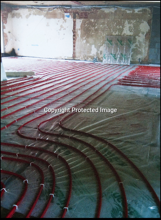 BNPS.co.uk (01202 558833)<br /> Pic: PhilYeomans/BNPS<br /> <br /> Carol even fitted underfloor heating.<br /> <br /> Plucky Carol Sullivan turned a £160,000 black hole left by cowboy builders into one million pound house - after building her dream home herself.<br /> <br /> Carol was left severley out of pocket after her luxury home was built with sub-standard mortar - meaning the whole structure had to be pulled down when the project was half way through.<br /> <br /> After firing the builders and waving goodbye to £160,000, undaunted Carol(50) enrolled on a bricklaying course at her local college and learned how to build the house herself. <br /> <br /> Further courses in carpentry and plumbing  have enabled determined Carol to complete the project in a year. The house is now thought to worth £1 million.