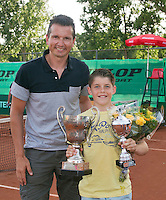 August 9, 2014, Netherlands, Rotterdam, TV Victoria, Tennis, National Junior Championships, NJK,  Prize giving, Richard Krajicek with Jens Hoogendam, winner  boys 12 years<br /> Photo: Tennisimages/Henk Koster