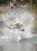 NWA Democrat-Gazette/FLIP PUTTHOFF <br /> Will Lange of Springdale pedals into Lee Creek at high speed on April 6 2019 during the big splash contest at the 31st annual Ozark Mountain Bike Festival at Devil's Den State Park near Winslow. Bikers rode into the creek to see who could make the biggest splash.