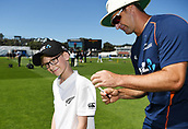 1st December 2017, Basin Reserve, Wellington, New Zealand; International Test Cricket, Day 1, New Zealand versus West Indies;  Colin de Grandhomme signs an autograph for 9 yr old ANZ Coin toss winner Jack Mahoney