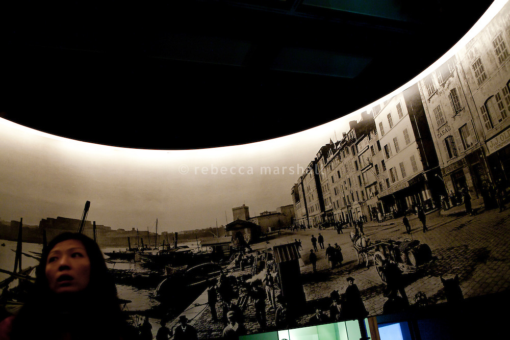 A visitor looks at the 'Photorama Lumiere' display at the Institut Lumiere, Lyon, France, 13 January 2012