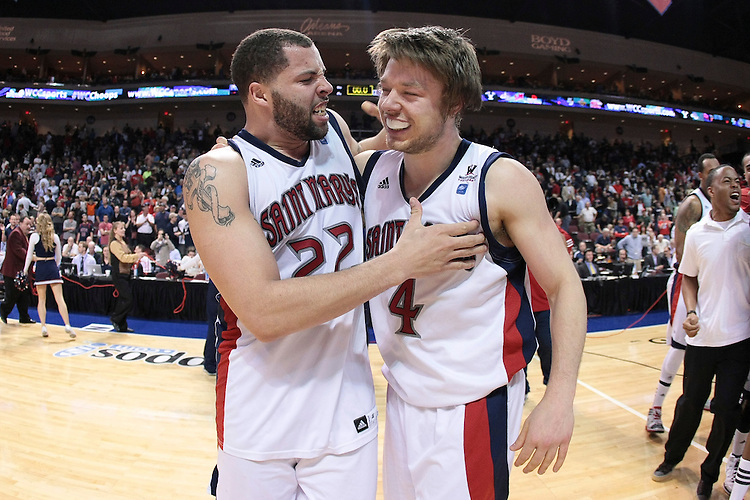 March 05, 2012; Las Vegas, NV, USA; Saint Mary's Gaels forward Rob Jones (22) and guard Matthew Dellavedova (4) celebrate after defeating the Gonzaga Bulldogs during the WCC Basketball Championships finals at Orleans Arena. The Saint Mary's Gaels defeated the Gonzaga Bulldogs 78-74 in overtime.