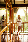 BELIZE, Punta Gorda, Toledo, a guest enjoying the private veranda for lounging at Belcampo Belize Lodge and Jungle Farm