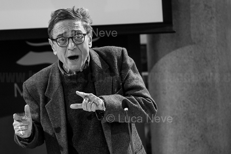 """Saverio Lodato.<br /> <br /> Rome, 08/02/2019. Moby Dick Library & Cultural Hub in Garbatella district & Antimafia Duemila (2.) held the presentation of the book """"Il Patto Sporco"""" (The Dirty Pact. The Trial State-mafia in the Story [narrated] by his Protagonist, Chiarelettere, 1.) hosted by the author of the book Saverio Lodato (Journalist & Author), Antonino 'Nino' Di Matteo (Protagonist of the book, Antimafia Magistrate of Palermo, member of the DNA - Antimafia & Antiterrorism National Directorate - who """"prosecuted the Italian State for conspiring with the Mafia in acts of murder and terror"""", 3.4.5.6.) & Giorgio Bongiovanni (Editor of Antimafia Duemila). Chair of the event was Silvia Resta (Journalist & Author). Readers were: Bianca Nappi & Carlotta Natoli (both Actresses). From the back cover of the book: """"Let us ask ourselves why politics, institutions, culture, have needed the words of judges to finally begin to understand…A handful of magistrates and investigators have shown not to be afraid to prosecute the [Italian] State. Now others must do their part too"""" (Nino Di Matteo). """"In the pages of this book I wanted the magistrate, the man, the protagonist and the witness to speak about a trial destined to leave its mark"""" (Saverio Lodato). From the book online page: """"The attacks to Lima [politician], Falcone & Borsellino [Judges], the bombs in Milan, Florence, Rome, the murders of valiant police commissioners & officers of the carabinieri. The [Italian] State on its knees, its best men sacrificed. However, while the blood of the massacres was still running there were those who, precisely in the name of the State, dialogued and interacted with the enemy. The sentence of condemnation of Palermo [""""mafia-State negotiation"""" trial which is told in the book], against the opinion of many 'deniers', proved that the negotiation not only was there but did not avoid more blood. On the contrary, it provoked it"""" (1.).<br /> Footnotes & links are provide at the 2nd & last pages """