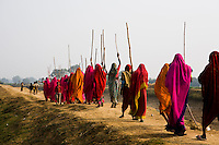 Members of the 10,000 strong Gulabi Gang march through Banda. In the badlands of Bundelkhand, one of the poorest parts of one of India's most populous states, a gang of female vigilantes have sprung up to fight the oppression of a caste-ridden, feudalistic and male dominated society. In a land where dowry demands and domestic and sexual violence are common, the 'Gulabi Gang' (Pink Gang), so called for their uniform of shocking pink saris, are picking up their lathis (traditional Indian sticks) to fight against corruption and violence against women.