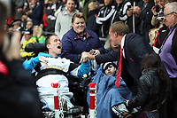 Pictured: Liverpool manager Brendan Rodgers (R) greets a disabled Swansea supporter. Monday 16 September 2013<br />