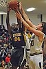 Isaiah Bien-Aise #24 of Westbury, left, grabs an offensive rebound before scoring and drawing a foul in a Nassau County varsity boys basketball game against host Baldwin High School on Tuesday, Jan. 17, 2017. Westbury won by a score of 63-57.