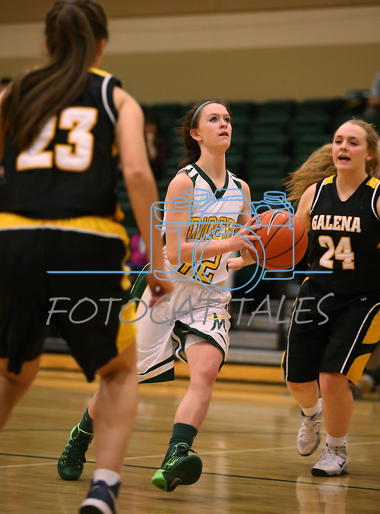 Manogue's Kaileigh Joanis drives past Galena defenders Natalie Young, left, and Mackenzi McKee at Manogue High School in Reno, Nev., on Tuesday, Feb. 11, 2014. Manogue won 51-29.<br /> Photo by Cathleen Allison