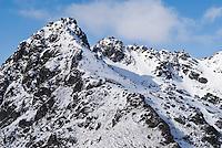 Mountain peak Steinetind above Stamsund covered in spring snow, Vestvagoy, Lofoten islands, Norway