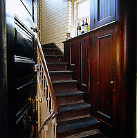 The unrestored service staircase to the apartment dates from 1895