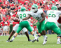 The Georgia Bulldogs played North Texas Mean Green at Sanford Stadium.  After North Texas tied the game at 21 early in the second half, the Georgia Bulldogs went on to score 24 unanswered points to win 45-21.  North Texas Mean Green running back Reggie Pegram (2) pitches the ball to North Texas Mean Green quarterback Derek Thompson (7) in an attempted flea flicker.