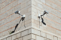Security cameras on the side of a building.
