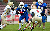 09 MAY 2010 - NORTHAMPTON, GBR - Birmingham Lions running back Chika Kalu looks for a route through the Loughborough Aces defence during the British Universities American Football Championship Final (PHOTO (C) NIGEL FARROW)