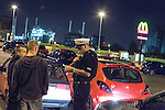© Joel Goodman - 07973 332324 . 16 August 2013 . Manchester , UK . Inspector Bailey-Smith speaks to two drivers seen racing through Trafford Park and Eccles , at drivethrough McDonalds in Eccles . The pair are due to be summonsed for careless driving and will get section 59 warnings . Drive along with Inspector Matt Bailey-Smith ( 16366 ) of Greater Manchester Police 's Serious Collision Unit . Photo credit : Joel Goodman