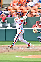 Clemson Tigers catcher Chris Okey (25) swings at a pitch during a game against the Notre Dame Fighting Irish during game one of a double headers at Doug Kingsmore Stadium March 14, 2015 in Clemson, South Carolina. The Tigers defeated the Fighting Irish 6-1. (Tony Farlow/Four Seam Images)