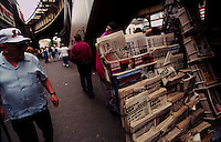(950601-SWR06) BROOKLYN, NEW YORK -- File Photo -- Russian language publications fill the racks at a newspaper stand under the elecated subway on  Brighton Beach Avenue..Photo  © Stacy Walsh Rosenstock