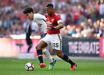 Luis Antonio Valencia of Manchester United is challenged by Son Heung-Min of Tottenham Hotspur during the FA cup semi-final match at Wembley Stadium, London. Picture date 21st April, 2018. Picture credit should read: Robin Parker/Sportimage