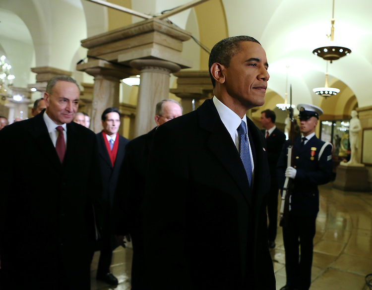 U.S. President Barack Obama walks through the U.S. Capitol on his way to being sworn-in for a second term by Supreme Court Chief Justice John Roberts during his public inauguration ceremony at the U.S. Capitol Building in Washington, D.C. on January 21, 2013. President Obama was joined by First Lady Michelle Obama and daughters Sasha and Malia. UPI/Molly Riey