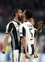 Football Soccer: UEFA Champions UEFA Champions League quarter final first leg Juventus-Barcellona, Juventus stadium, Turin, Italy, April 11, 2017. <br /> Juventus Giorgio Chiellini (l) celebrates with his teammate Paulo Dybala (c) and Miralem Pjanic (r) after scoring during the Uefa Champions League football match between Juventus and Barcelona at the Juventus stadium, on April 11 ,2017.<br /> UPDATE IMAGES PRESS/Isabella Bonotto