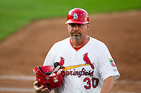 Hitting Coach Phillip Wellman (30) of the Springfield Cardinals walks back to the dugout during a game against the Arkansas Travelers at Hammons Field on June 12, 2012 in Springfield, Missouri. (David Welker/Four Seam Images)