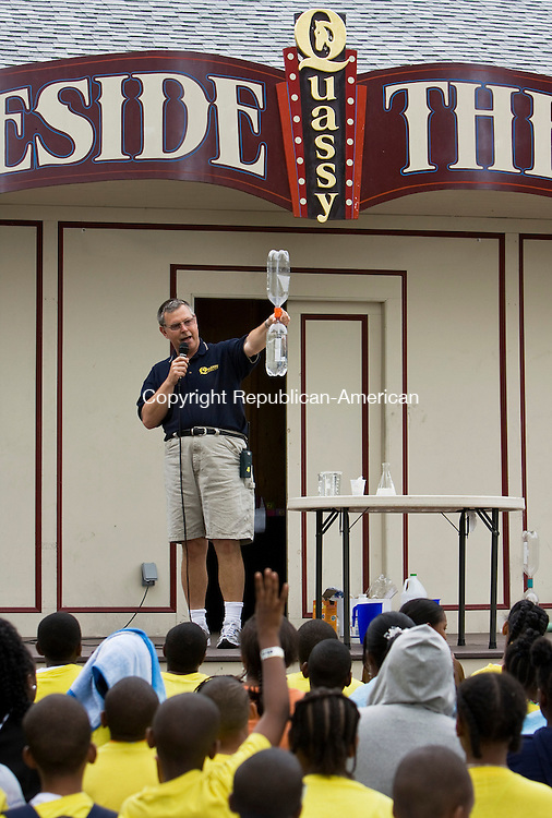 MIDDLEBURY, CT-  15 June 2010- 061610BF04- Ron Gustafson, director of public relations and educational programs at Quassy Amusement Park demonstrates how to create a vacuum using two-litre soda bottles during the Wacky Science presentation Wendesday at the park in Middlebury.  Bob Falcetti Republican-American