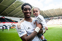 Leroy Fer on the pitch with team players and staff during a lap of honour after the Barclays Premier League match between Swansea City and Manchester City played at the Liberty Stadium, Swansea on the 15th of May  2016