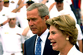 Coronado, Calif. (Aug. 30, 2005) - President George W. Bush and First Lady Laura Bush walk past a crowd of Sailors prior to delivering a speech in commemoration of the 60th anniversary of the victory over Japan (VJ Day) during World War II. The ceremony was held on board Naval Air Station North Island and was attended by area service members. <br /> Mandatory Credit: Kevin S. O'Brien / US Navy via CNP