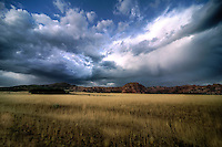 Passing storm clouds appear over Kolob Terrace at Zion National Park, Utah