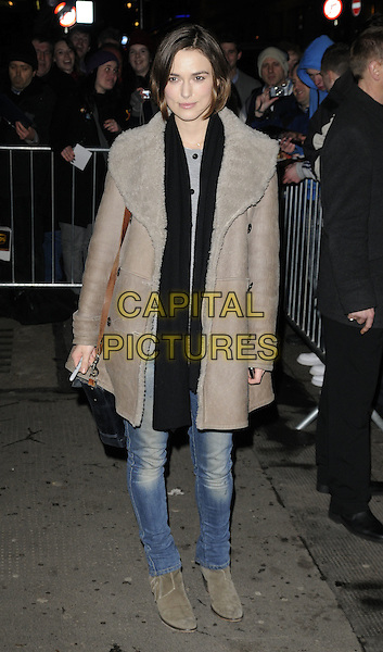 KEIRA KNIGHTLEY .Departs the theatre after a performance of 'The Children's Hour', Comedy Theatre, Panton Street, London, England, UK, January 24th 2010..full length brown grey gray suede  sheepskin shearling coat ankle boots beige brown bag black scarf skinny jeans .CAP/CAN.©Can Nguyen/Capital Pictures.