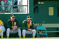 PHOENIX, AZ - Manager Tony La Russa of the Oakland Athletics (right) talks with pitching coach Dave Duncan during a spring training game against the San Francisco Giants at Phoenix Municipal Stadium in Phoenix, Arizona in 1992. Photo by Brad Mangin