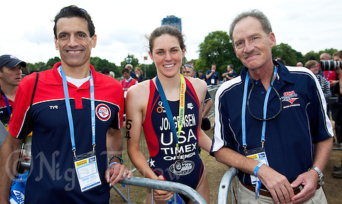 06 AUG 2011 - LONDON,GBR - Gwen Jorgensen (USA) poses for a picture with Rob Urbach, Chief Executive Officer of USA Triathlon, (left) and with Bob Wendling, President of the USA Triathlon Board of Directors (right), after she took second place at the women's round of triathlon's ITU World Championship Series .(PHOTO (C) NIGEL FARROW)