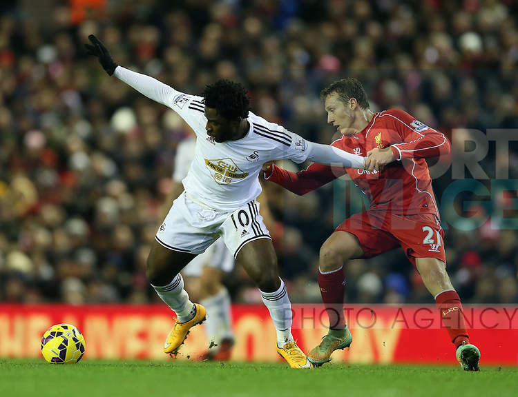 Wilfried Bony of Swansea City holds off Lucas Leiva of Liverpool - Barclays Premier League - Liverpool vs Swansea City - Anfield Stadium - Liverpool - England - 29th December 2014  - Picture Simon Bellis/Sportimage