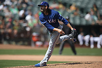 OAKLAND, CA - AUGUST 22:  Cory Gearrin #44 of the Texas Rangers pitches against the Oakland Athletics during the game at the Oakland Coliseum on Wednesday, August 22, 2018 in Oakland, California. (Photo by Brad Mangin)