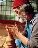 JAPAN, Kyushu, master potter Takashi Nakazawa throwing a tea cup