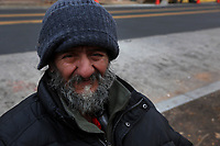 (171115RREI1332) Carlos Munoz, wheel chair bound, in front of Progreso Market at La Esquina where Latinos have gathered for decades at the corner of Mt. Pleasant St. and Kenyon St. NW. to play chekers (damas). Washington DC.  Nov. 15 ,2017 . ©  Rick Reinhard  2017     email   rick@rickreinhard.com