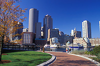 Boston, Massachusetts, MA, View of the downtown skyline of Boston from Boston Inner Harbor from a city park in the fall.
